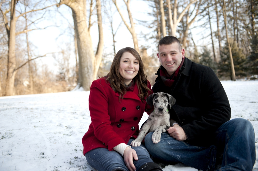 Engagement Photography - Winter couple sitting in snow with puppy