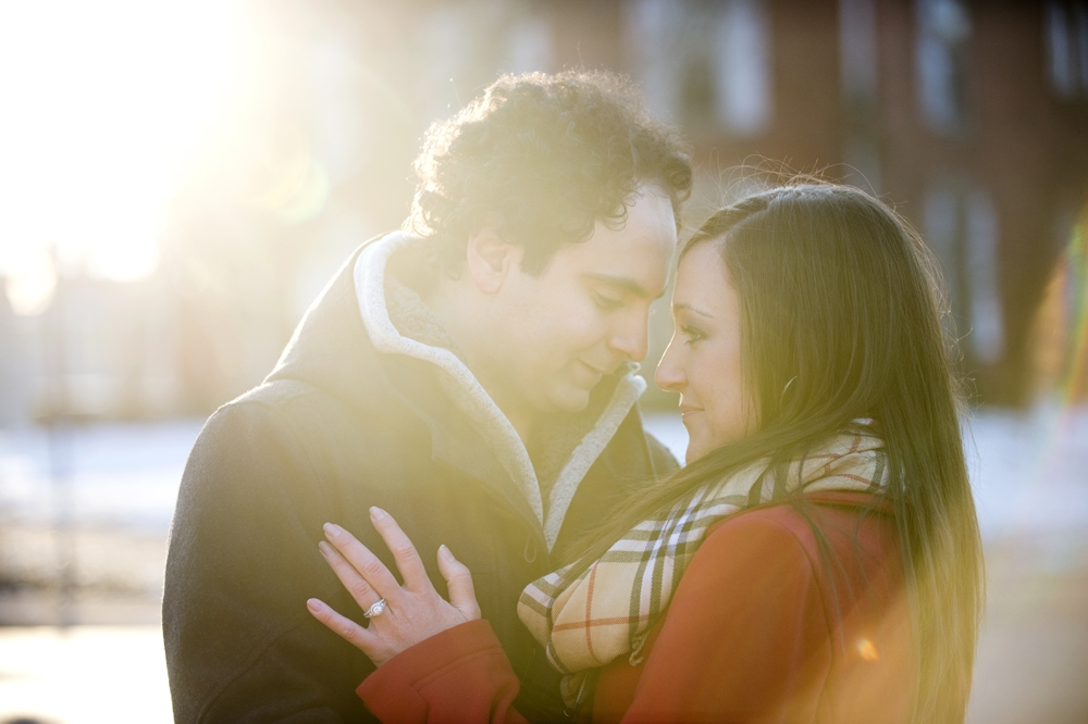Engagement Photography - Winter couple embracing and showing engagement ring