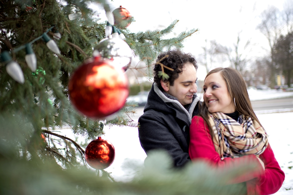 Engagement Photography - Winter couple embracing next to Christmas tree