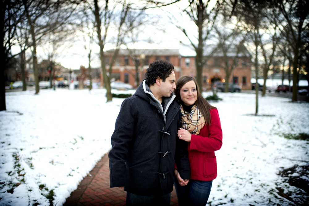 Engagement Photography - Winter couple walking down snowy brick path
