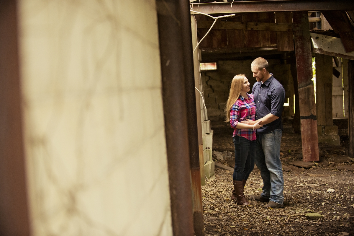 Engagement Photography - Couple hugging in Autumn barn