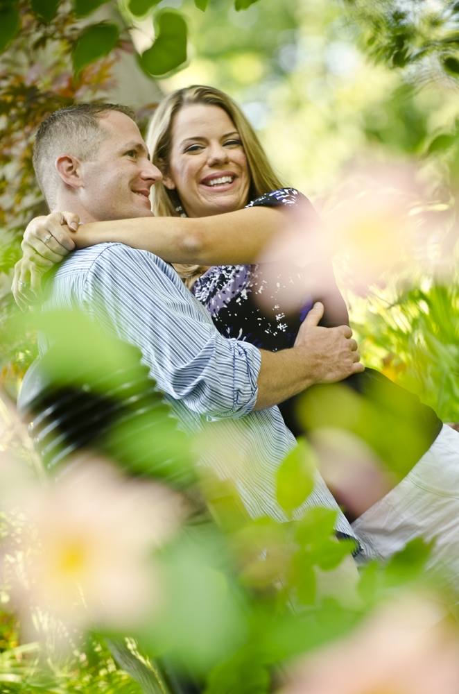 Engagement Photography - Outdoor couple hugging and smiling at each other