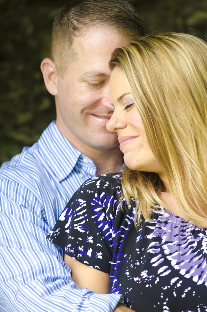Engagement Photography - Outdoor couple embracing and smiling
